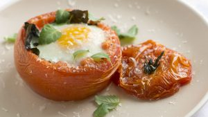 Fill the center of a tomato with an egg and bake it.