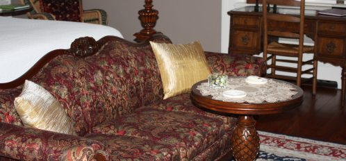 The Dunkin-fith sofa in the General James Chesnut room is jewel tones and soft.