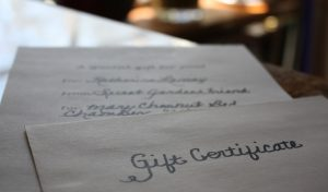A Bloomsbury Gift Certificate printed on fine linen paper awaits the perfect gift package