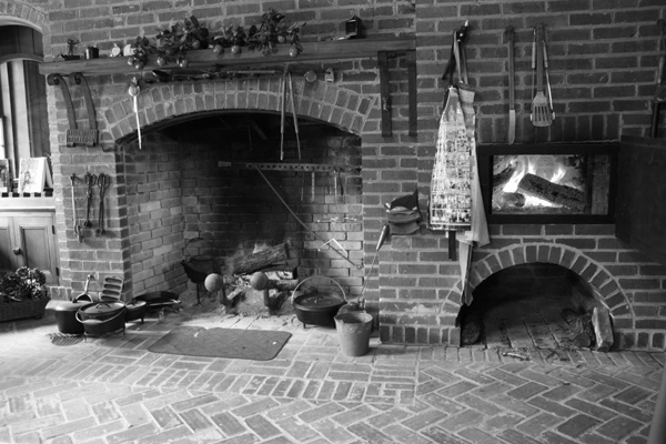 Cooking, cast iron, on open fire in old kitchen house, Bloomsbury Inn