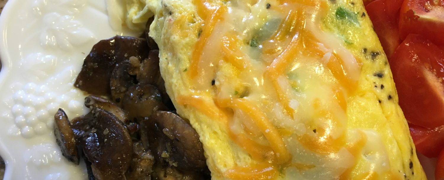 A perfect omelet served with fresh vegetables.