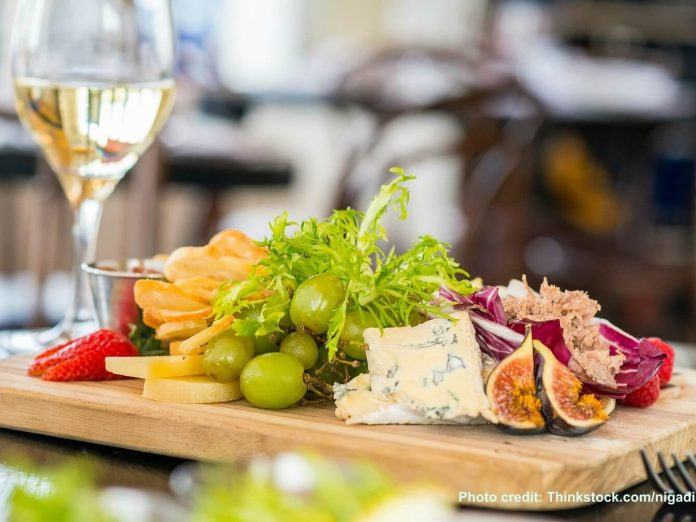 Afternoon social at Bloomsbury Inn features a variety of wines and light hors d'oeuvres like this beautiful wooden snack board.