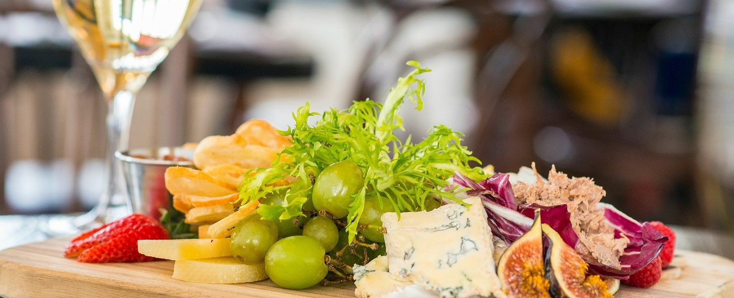 For a romantic weekend, enjoy a lovely glass of wine and a cheese board in the comfort of your room, Bloomsbury Inn.