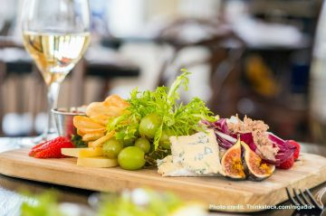 Enjoy a lovely glass of wine and a cheese board in the comfort of your room, Bloomsbury Inn.