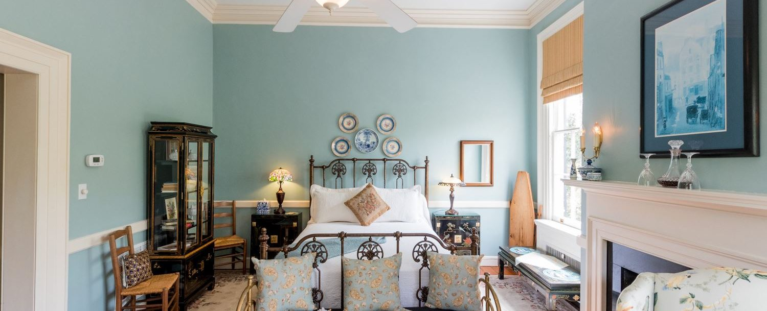 A queen iron bed is the highlight of the Sweet Williams' room at Bloomsbury Inn.