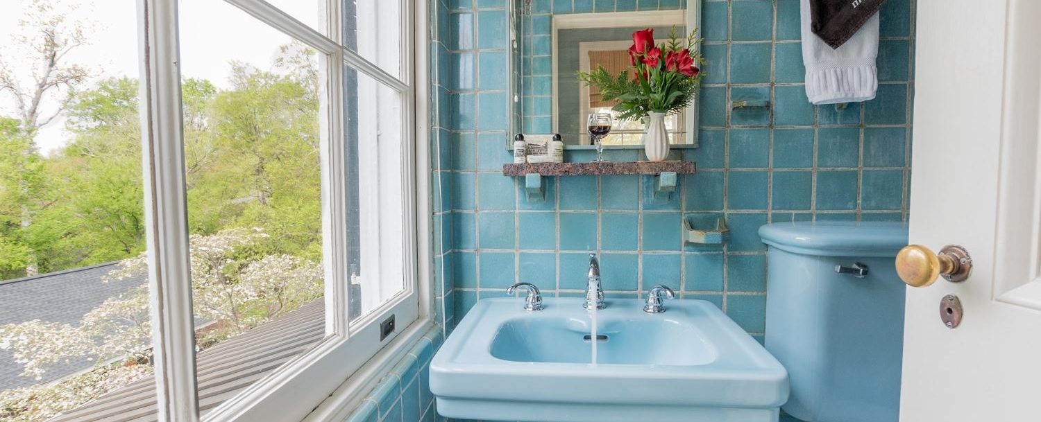 The private bath with Sweet Williams Room at Bloomsbury Inn is done in Italian tile, Robin Egg blue.
