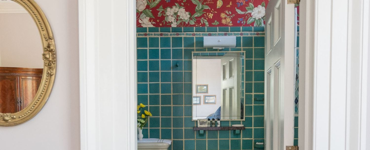 Private bath, beautiful green Italian tile, at Bloomsbury Inn.