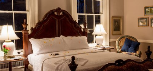 An inviting bed, all set for you, Bloomsbury Inn.