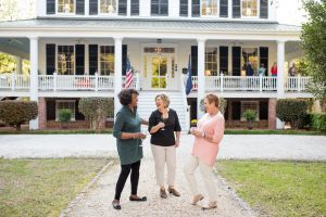 Three guests are just enjoying themselves in front of Bloomsbury Inn in Camden SC.