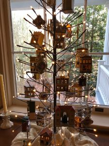 Two trees in the Dining Room host hallmark holiday houses.