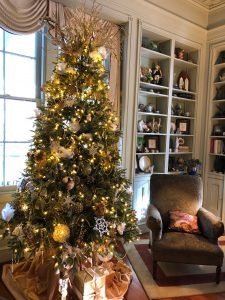 The tree in the Ladies' Parlor is decorated in gold and cream.