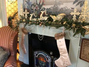 Satin and mink stockings hang at the fireplace in the Ladies' Parlor.