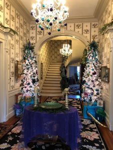 At Bloomsbury Inn, the grand hallway features 2 trees all decked out in peacock colors.