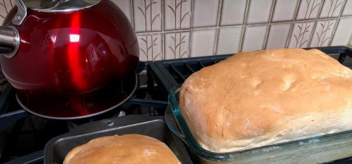 Two loafs of fresh white bread just out of the oven