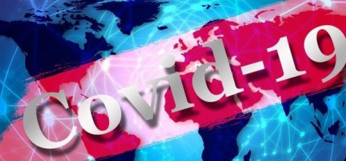 Blue background of the world, overlaid with the words Covid-19
